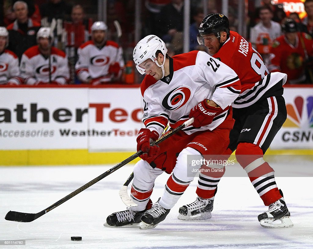 Brett Pesce #22 of the Carolina Hurricanes steals the puck from Marian Hossa #81 of the Chicago Blackhawks at the United Center on January 6, 2017 in Chicago, Illinois. The Blackhawks defeated the Hurricanes 2-1.