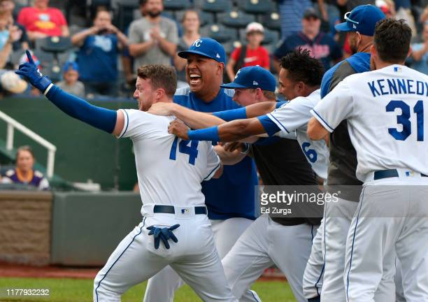 Brett Phillips of the Kansas City Royals celebrates his game-winning sacrifice fly with teammates in the ninth inning against the Minnesota Twins at...