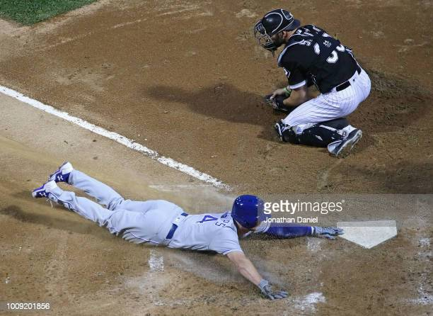 Brett Phillips of the Kansas City Royals slides in to score a run as Kevan Smith of the Chicago White Sox takes the late throw in the 4th inning at...