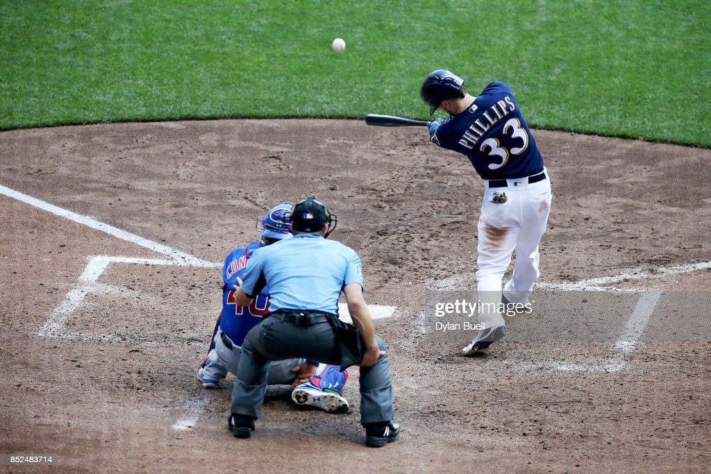 Brett Phillips #33 of the Milwaukee Brewers hits a single in the sixth inning against the Chicago Cubs at Miller Park on September 23, 2017 in Milwaukee, Wisconsin.
