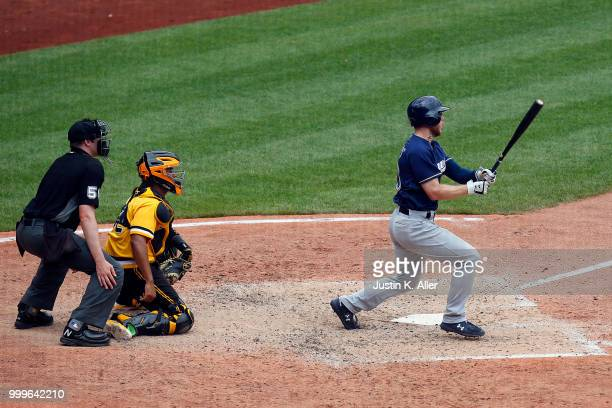 Brett Phillips of the Milwaukee Brewers hits a three RBI triple in the eighth inning against the Pittsburgh Pirates at PNC Park on July 15 2018 in...