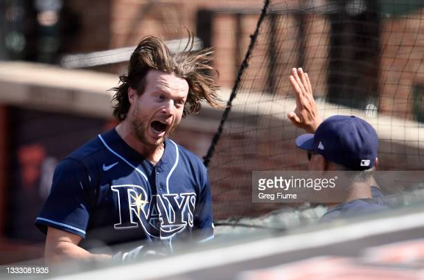 Brett Phillips of the Tampa Bay Rays celebrates after hitting a grand slam in the eighth inning against the Baltimore Orioles at Oriole Park at...