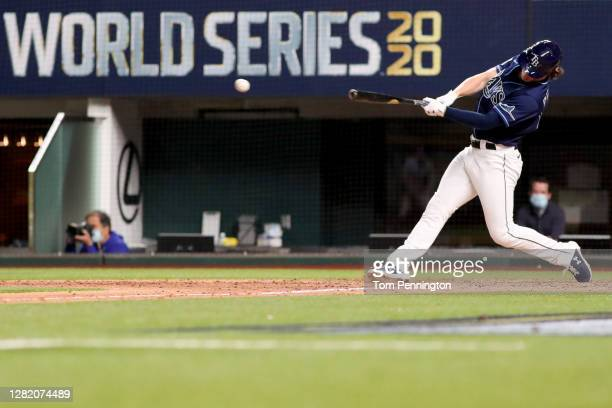 Brett Phillips of the Tampa Bay Rays hits a ninth inning two-run walk-off single to defeat the Los Angeles Dodgers 8-7 in Game Four of the 2020 MLB...