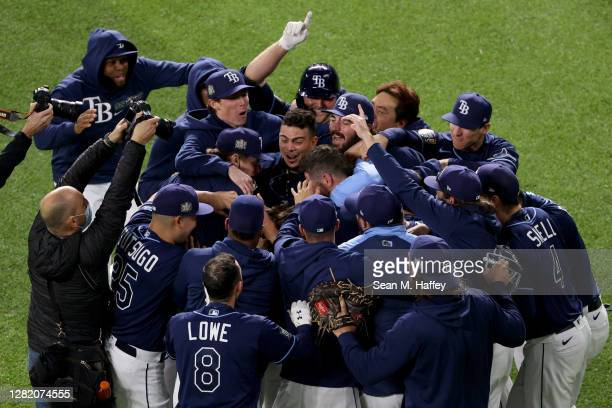 Brett Phillips of the Tampa Bay Rays is congratulated by his teammates after hitting a ninth inning two-run walk-off single to defeat the Los Angeles...