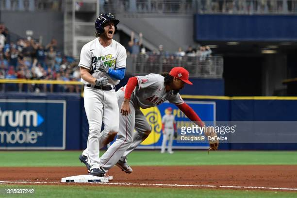 Brett Phillips of the Tampa Bay Rays reacts after hitting a two run triple during the fourth inning against the Los Angeles Angels at Tropicana Field...