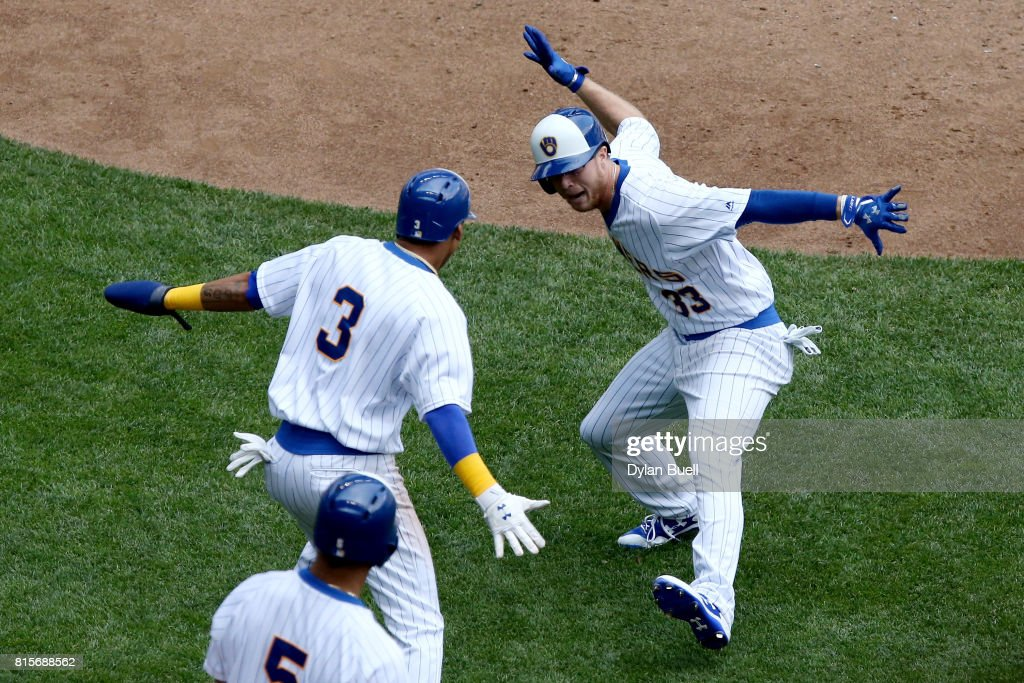Brett Phillips #33, Orlando Arcia #3, and Jonathan Villar #5 of the Milwaukee Brewers celebrate after Phillips hit a home run in the fifth inning against the Philadelphia Phillies at Miller Park on July 16, 2017 in Milwaukee, Wisconsin.