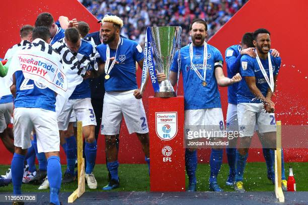 Brett Pitman and Portsmouth team mates celebrate victory following a penalty shootout in the Checkatrade Trophy Final between Portsmouth and...