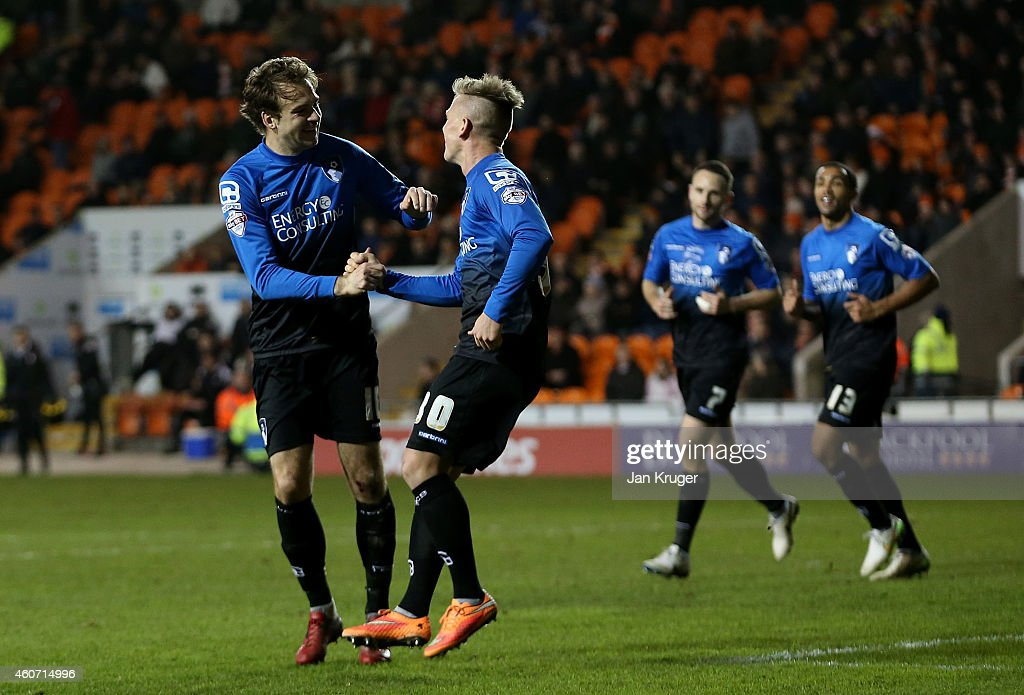 Brett Pitman of AFC Bournemouth celebrates his goal with Matt Ritchie during the Sky Bet Championship match between Blackpool and Bournemouth at Bloomfield Road on December 20, 2014 in Blackpool, England.