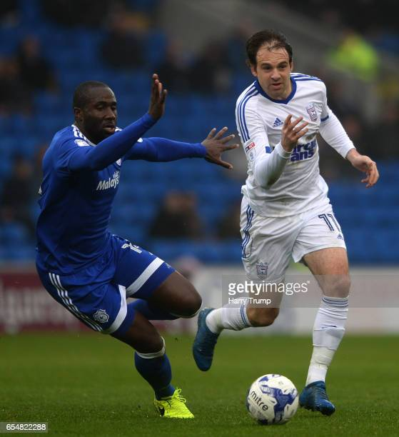 Brett Pitman of Ipswich Town is tackled by Sol Bamba of Cardiff City during the Sky Bet Championship match between Cardiff City and Ipswich Town at...