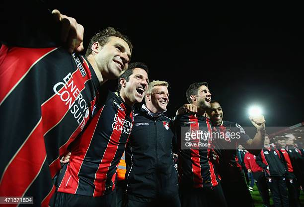 Brett Pitman, Yann Kermorgant, Eddie Howe manager of Bournemouth, Andrew Surman and Callum Wilson of Bournemouth celebrate victory on the pitch after...