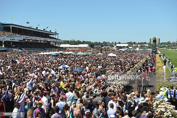 Brett Prebble riding Green Moon walks out onto the track in front of a huge crowd before winning the Emirates Melbourne Cup during Melbourne Cup Day...