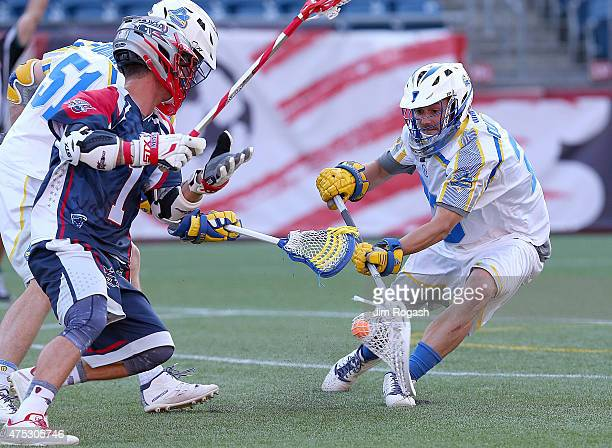 Brett Queener of Florida Launch feels the pressure of Will Manny of Boston Cannons in the first half at Gillette Stadium on May 30 2015 in Foxboro...