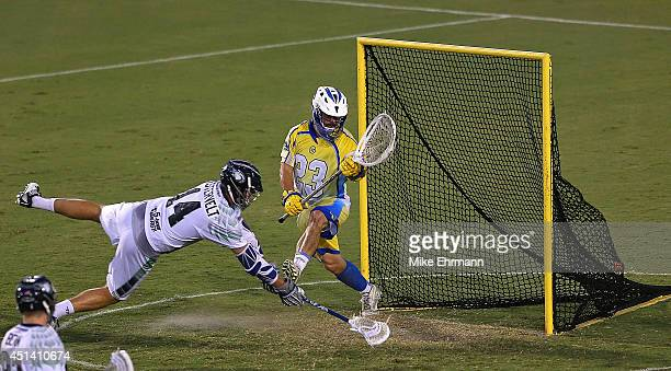 Brett Queener of the Florida Launch gives up a goal to Drew Westervelt of the Chesapeake Bayhawks during a game at FAU Stadium on June 28 2014 in...