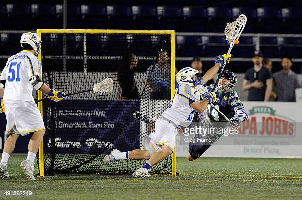 Brett Queener of the Florida Launch makes a save in the fourth quarter against Drew Westervelt of the Chesapeake Bayhawks at NavyMarine Corps...