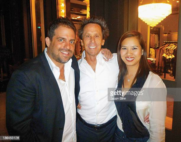 Brett Ratner Brian Grazer and Chosan Nguyen pose circa Octoberr 2009 in Las Vegas Nevada