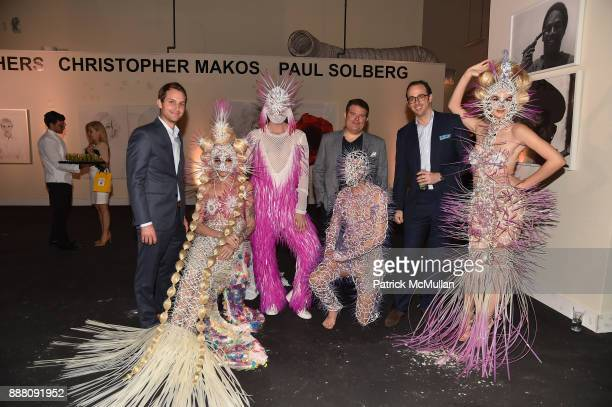 Brett Reese Michael Delmar and Tyler Ploshnick pose with performers during the Unveiling of White Square by Richard Meier Partners at Citigroup...