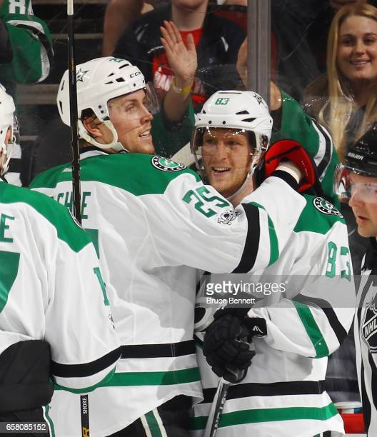 Brett Ritchie congratulates Ales Hemsky of the Dallas Stars of his game tying goal against the New Jersey Devils at the Prudential Center on March 26...