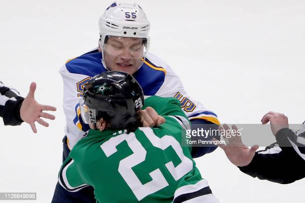 Brett Ritchie of the Dallas Stars fights with Colton Parayko of the St Louis Blues in the second period at American Airlines Center on February 21...