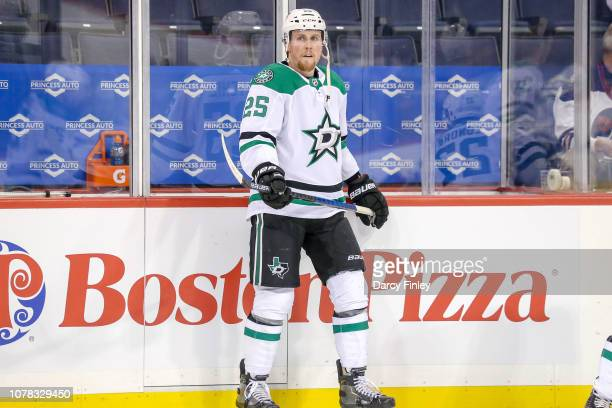 Brett Ritchie of the Dallas Stars looks on during the pregame warm up prior to NHL action against the Winnipeg Jets at the Bell MTS Place on January...