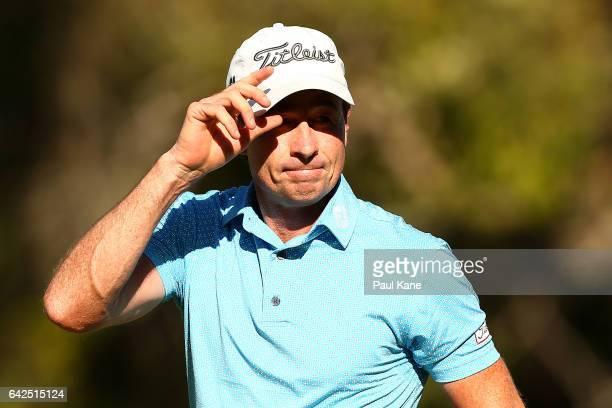 Brett Rumford of Australia acknowledges the gallery on the 18th green after completing his round during round three of ISPS HANDA World Super 6 Perth...