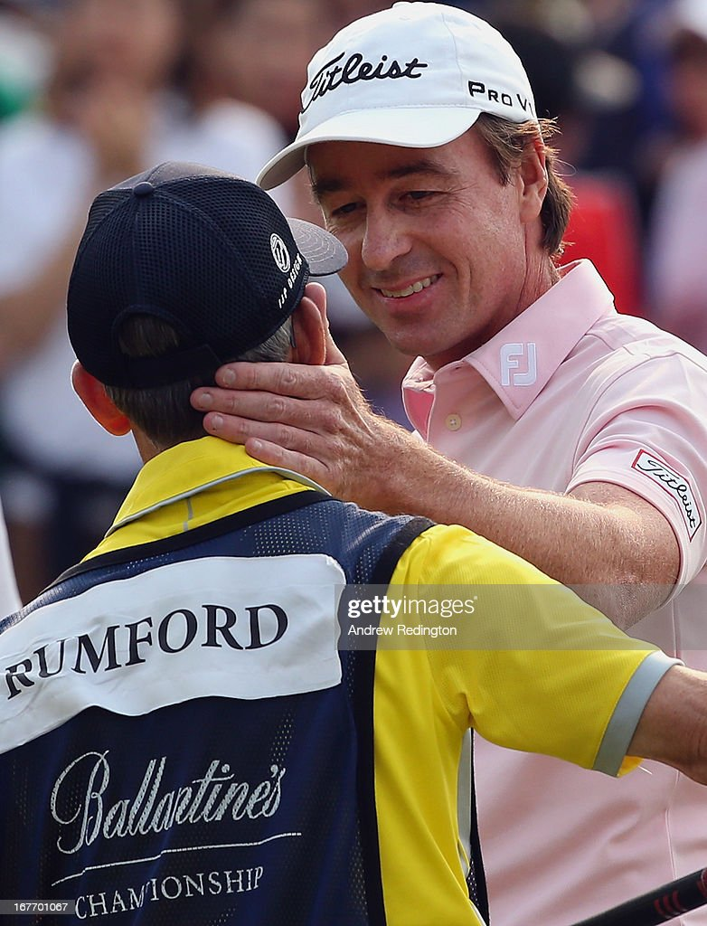 Brett Rumford of Australia celebrates with his caddie after holing an eagle putt at the first play-off hole to win the play-off and the Ballantine's Championship at Blackstone Golf Club on April 28, 2013 in Icheon, South Korea.