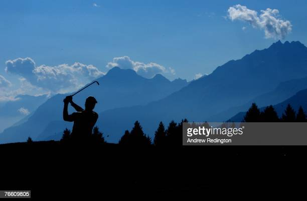Brett Rumford of Australia hits his second shot on the 17th hole during the final round of the Omega European Masters at CransSurSierre Golf Club on...
