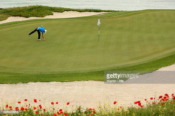 Brett Rumford of Australia marks his ball during the morning matches on day two of the Volvo World Match Play Championship at Thracian Cliffs Golf &...
