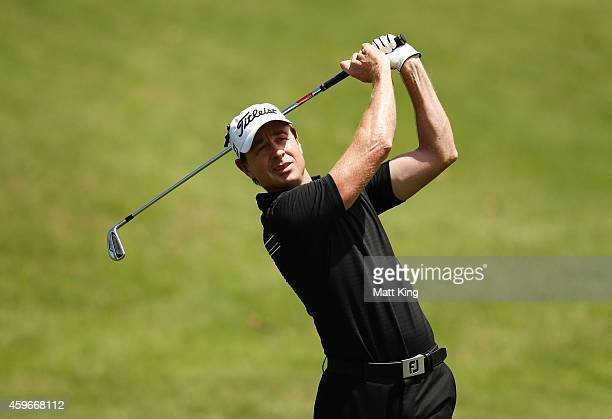 Brett Rumford of Australia plays a fairway shot on the 8th hole during day two of the Australian Open at The Australian Golf Course on November 28...