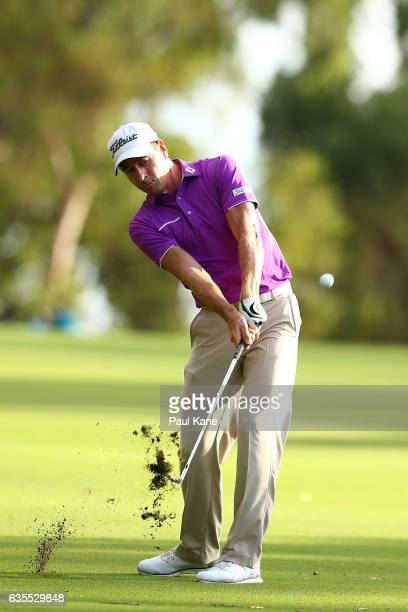 Brett Rumford of Australia plays his approach shot on the 13th hole during round one of the ISPS HANDA World Super 6 at Lake Karrinyup Country Club...