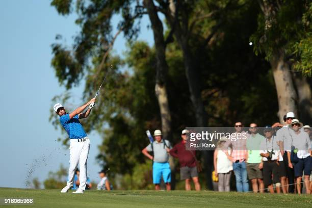 Brett Rumford of Australia plays his second shot on the 18th hole during day two of the World Super 6 at Lake Karrinyup Country Club on February 9...