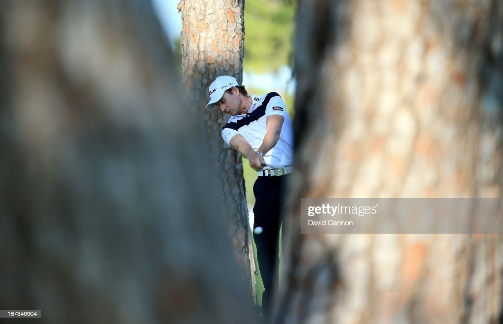 Brett Rumford of Australia plays his second shot through the trees at the par 5, 18th hole during the completion of his first round on day two of the 2013 Turkish Airlines Open on the Montgomerie Maxx Royal Course on November 8, 2013 in Antalya, Turkey.