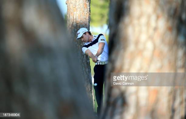 Brett Rumford of Australia plays his second shot through the trees at the par 5 18th hole during the completion of his first round on day two of the...