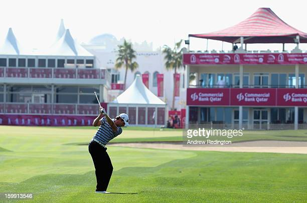 Brett Rumford of Australia plays his third shot on the 18th hole during the first round of the Commercial Bank Qatar Masters held at Doha Golf Club...