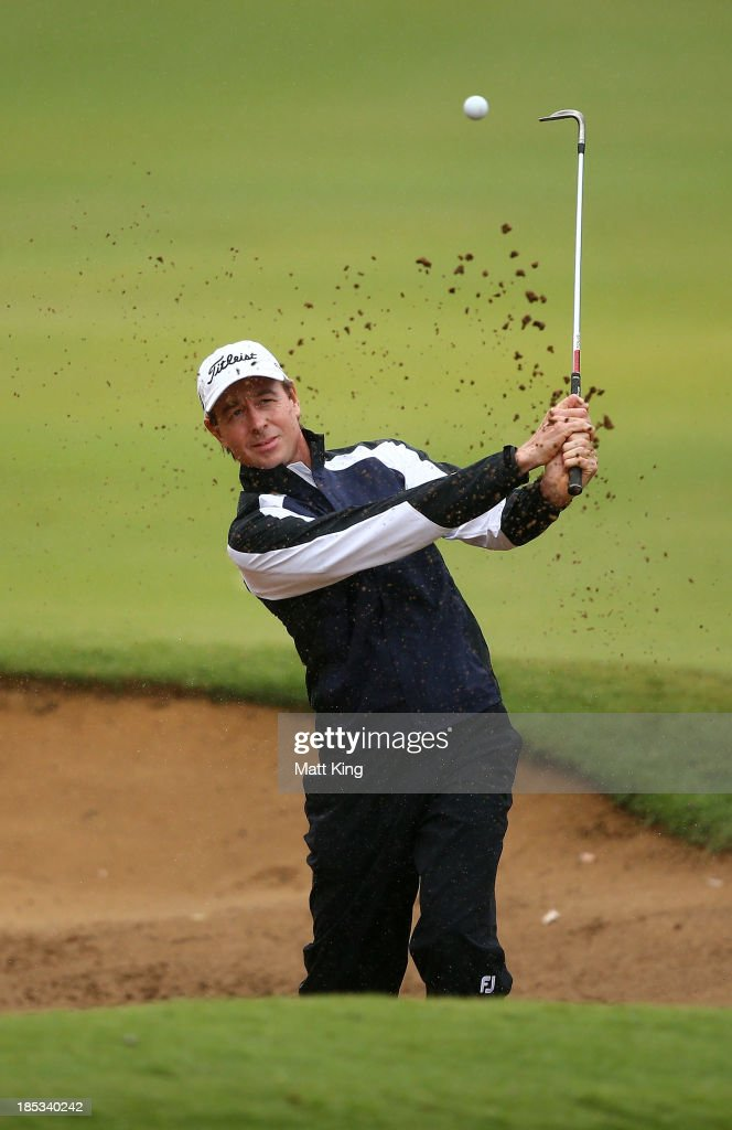 Brett Rumford of Australia plays out of the bunker on the 7th hole during day three of the Perth International at Lake Karrinyup Country Club on October 19, 2013 in Perth, Australia.