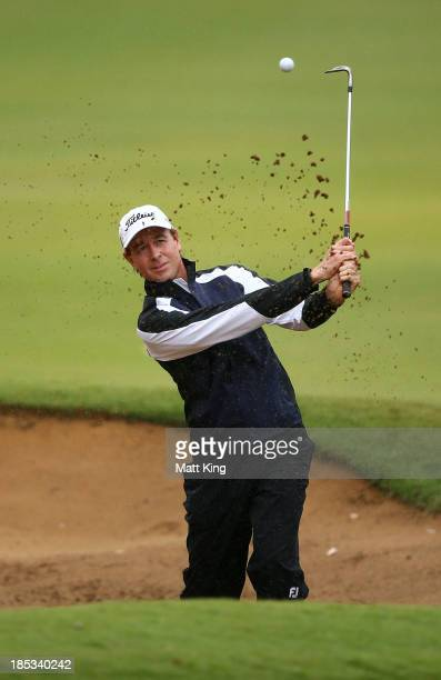Brett Rumford of Australia plays out of the bunker on the 7th hole during day three of the Perth International at Lake Karrinyup Country Club on...
