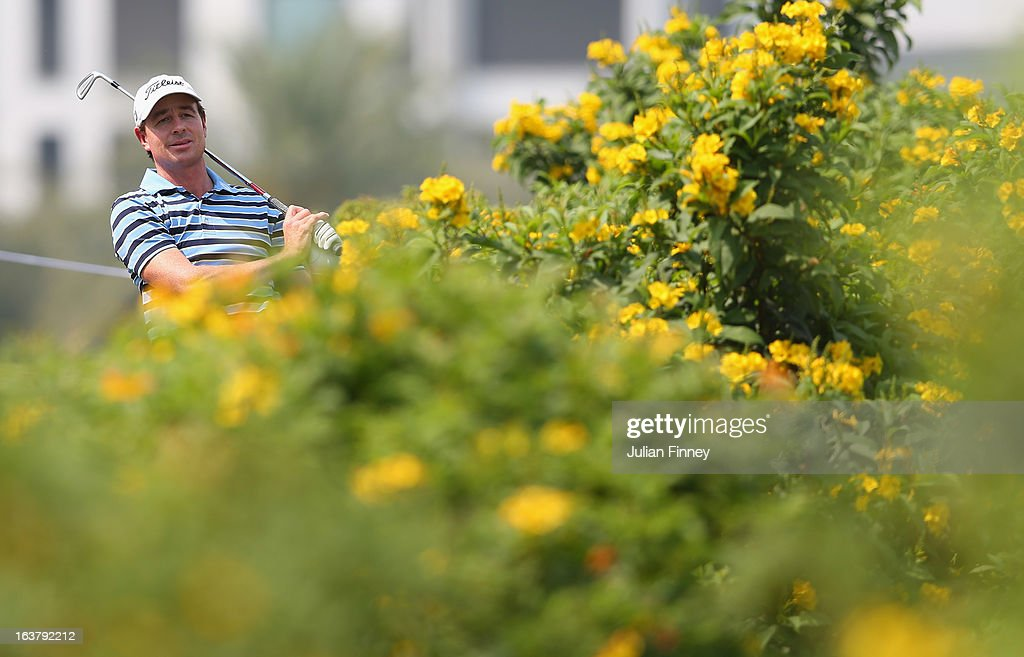 Brett Rumford of Australia plays out of the bushes during day three of the Avantha Masters at Jaypee Greens Golf Club on March 16, 2013 in Delhi, India.