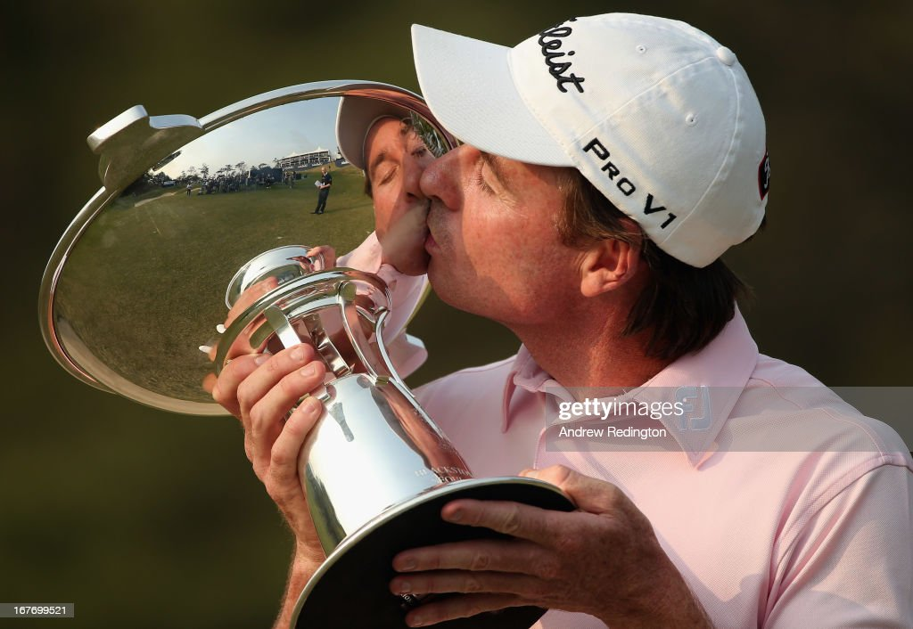 Brett Rumford of Australia poses with the trophy after winning the Ballantine's Championship at Blackstone Golf Club on April 28, 2013 in Icheon, South Korea.
