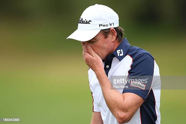 Brett Rumford of Australia reacts after bogeying his final hole during day three of the Perth International at Lake Karrinyup Country Club on October...