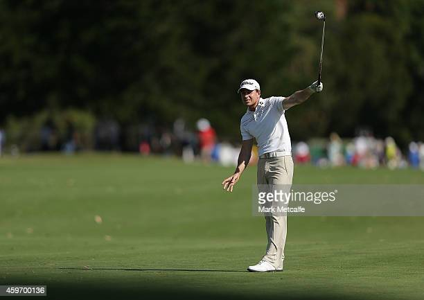 Brett Rumford of Australia reacts to hitting his approach shot wide of the 18th green during day three of the Australian Open at The Australian Golf...