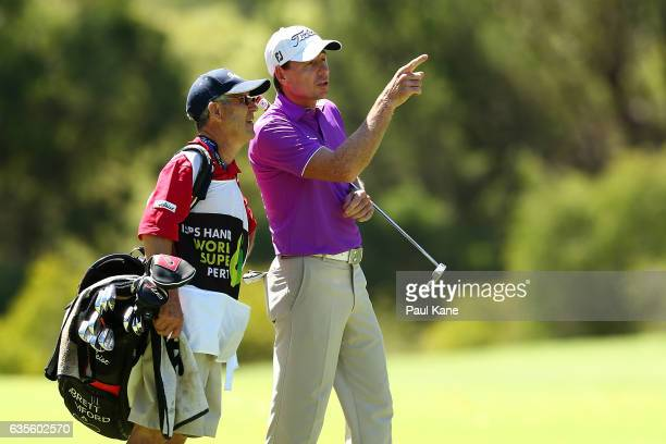 Brett Rumford of Australia talks with his caddie during round one of the ISPS HANDA World Super 6 at Lake Karrinyup Country Club on February 16 2017...