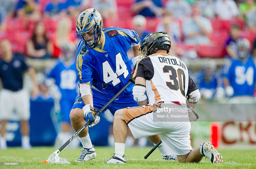 Brett Schmidt #44 of the Charlotte Hounds wins a face off against John Ortolani #30 of the Rochester Rattlers at American Legion Memorial Stadium on May 11, 2013 in Charlotte, North Carolina.