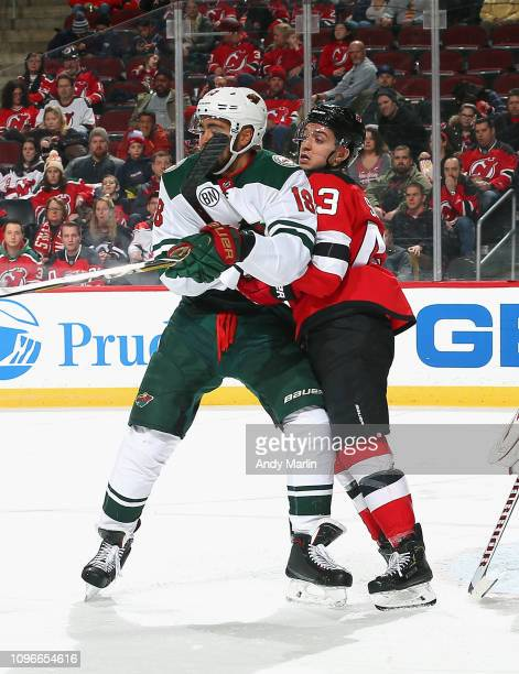 Brett Seney of the New Jersey Devils and Jordan Greenway of the Minnesota Wild battle for position during the game at Prudential Center on February 9...
