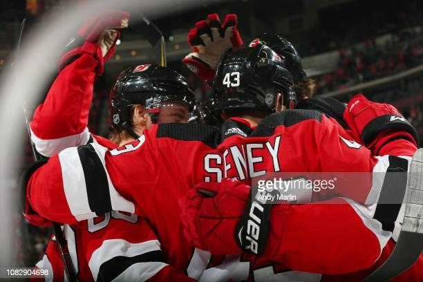 Brett Seney of the New Jersey Devils is congratulated after scoring a goal during the third period against the Chicago Blackhawks at the Prudential...