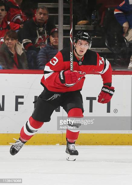 Brett Seney of the New Jersey Devils skates against the New York Islanders during the game at Prudential Center on February 7 2019 in Newark New...