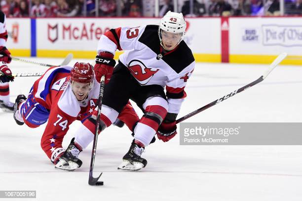 Brett Seney of the New Jersey Devils skates with the puck against John Carlson of the Washington Capitals in the second period at Capital One Arena...