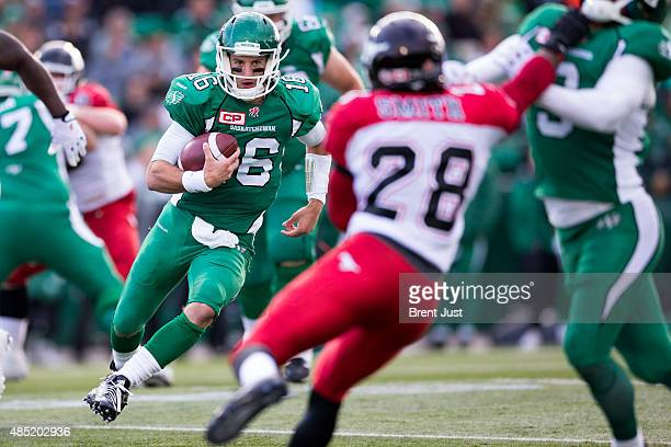 Brett Smith of the Saskatchewan Roughriders looks for a block as he scrambles in a game between the Calgary Stampeders and Saskatchewan Roughriders...