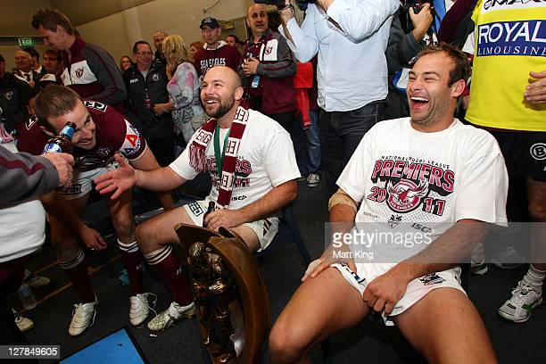 Brett Stewart and Glenn Stewart of the Sea Eagles celebrate victory in the dressing room after the 2011 NRL Grand Final match between the Manly...