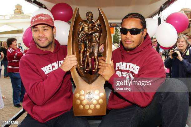 Brett Stewart and Steve Matai hold the NRL Premiership trophy in front of fans during the Manly Warringah Sea Eagles NRL Grand Final celebrations at...