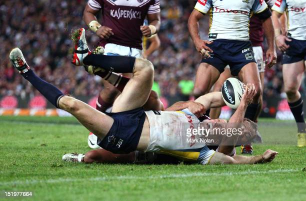 Brett Stewart of the Eagles holds up Brent Tate of the Cowboys during the NRL Semi Final match between the Manly Sea Eagles and the North Queensland...