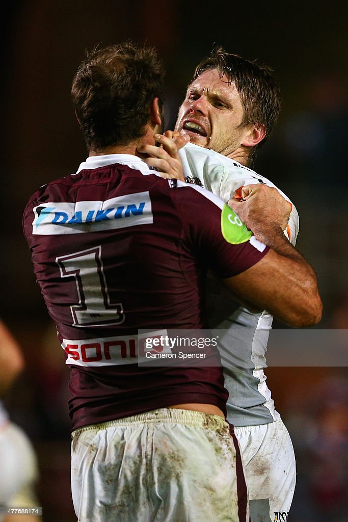 Brett Stewart of the Sea Eagles and Chris Lawrence of the Tigers exchange words during the round 15 NRL match between the Manly Sea Eagles and the Wests Tigers at Brookvale Oval on June 19, 2015 in Sydney, Australia.